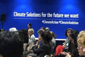 Sign reads Climate Solutions for the future we want.