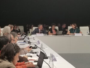 Secretary Crowfoot sitting at table with other climate change leaders.