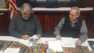Member of the Bishop Paiute Tribe and CDFW staff sign MOU